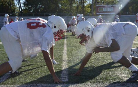 Atoms football players go head to head in team drills during a practice held on Oct. 16. As seen above, players make head to head contact in not only games but in practice as well.