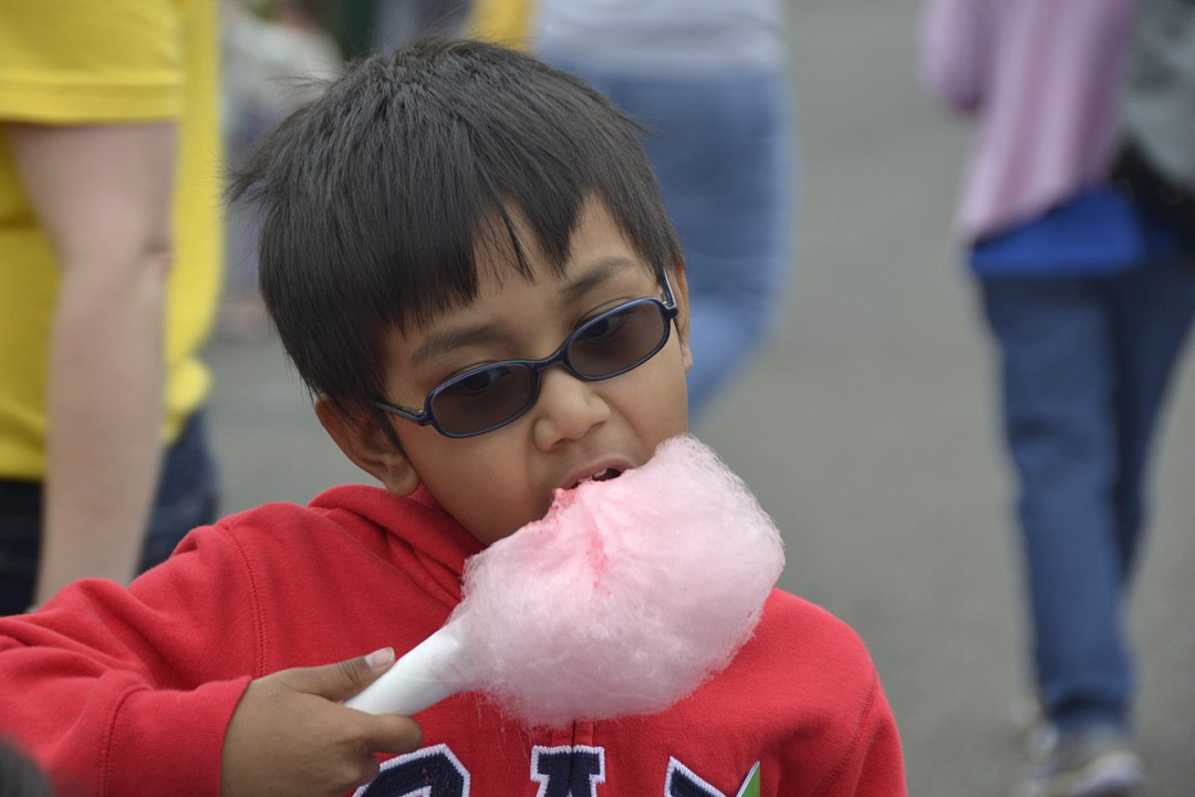 Taking+a+bite+out+of+the+event%2C+this+boy+munches+on+some+sweet+cotton+candy%2C+one+of+the+many+sugary+treats+they+had+to+offer+at+the+event.+