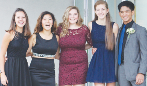 Seniors (right to left) Megan Lee, McKenzie Yi, Jessica Roop, Melissa WIlson, and Allen Kokilananda pose for a picture before last year's homecoming dance.