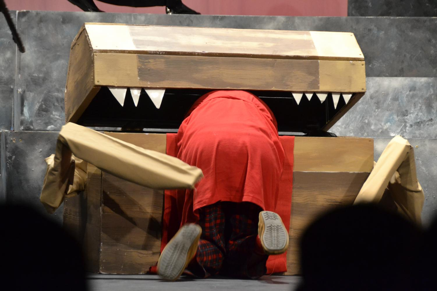 Orcus%3B+overlord+of+the+underworld%2C+gets+too+close+to+a+trap+and+gets+stuck+in+the+mouth+of+a+gigantic+wooden+box.