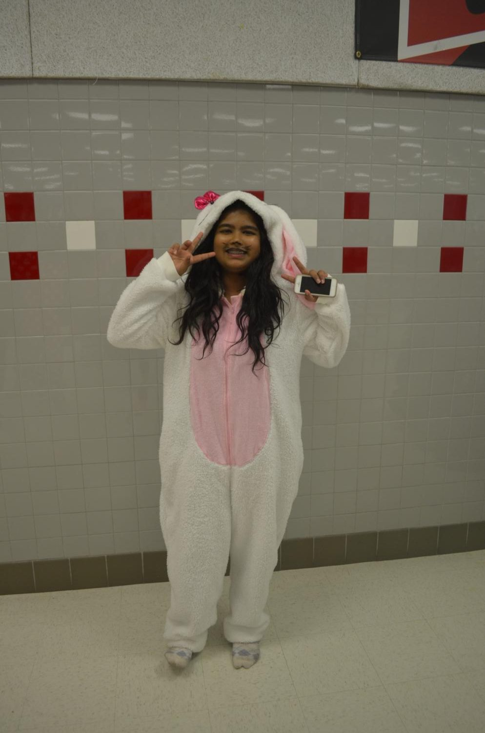 Sophomore+Farjana+Mim+dresses+up+as+a+bunny+in+a+onesie.