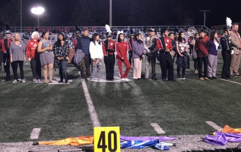 The Marching Band seniors await their name to be called.