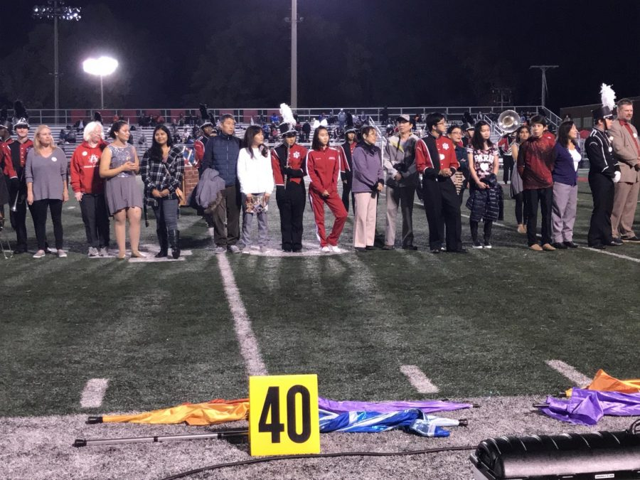 The+Marching+Band+seniors+await+their+name+to+be+called.