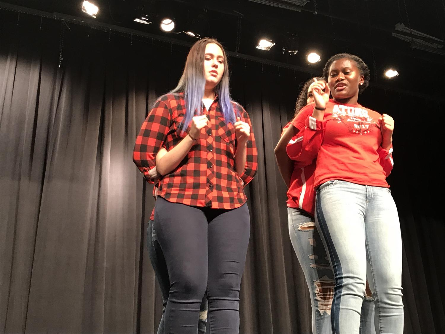 Junior Emily Trachsel is playing the arms of Junior Ioana Marin and Sophomore Makayla Collins is playing the arms of Sophomore Ave Clyburn during their improv game of arms.