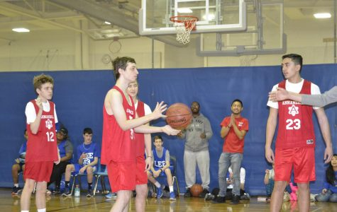 Thomas Winant prepares to take a shoot during the Atoms' Special Olympics team game against the Robert E. Lee Lancers Special Olympics team at Holmes Middle School on Jan. 14.
