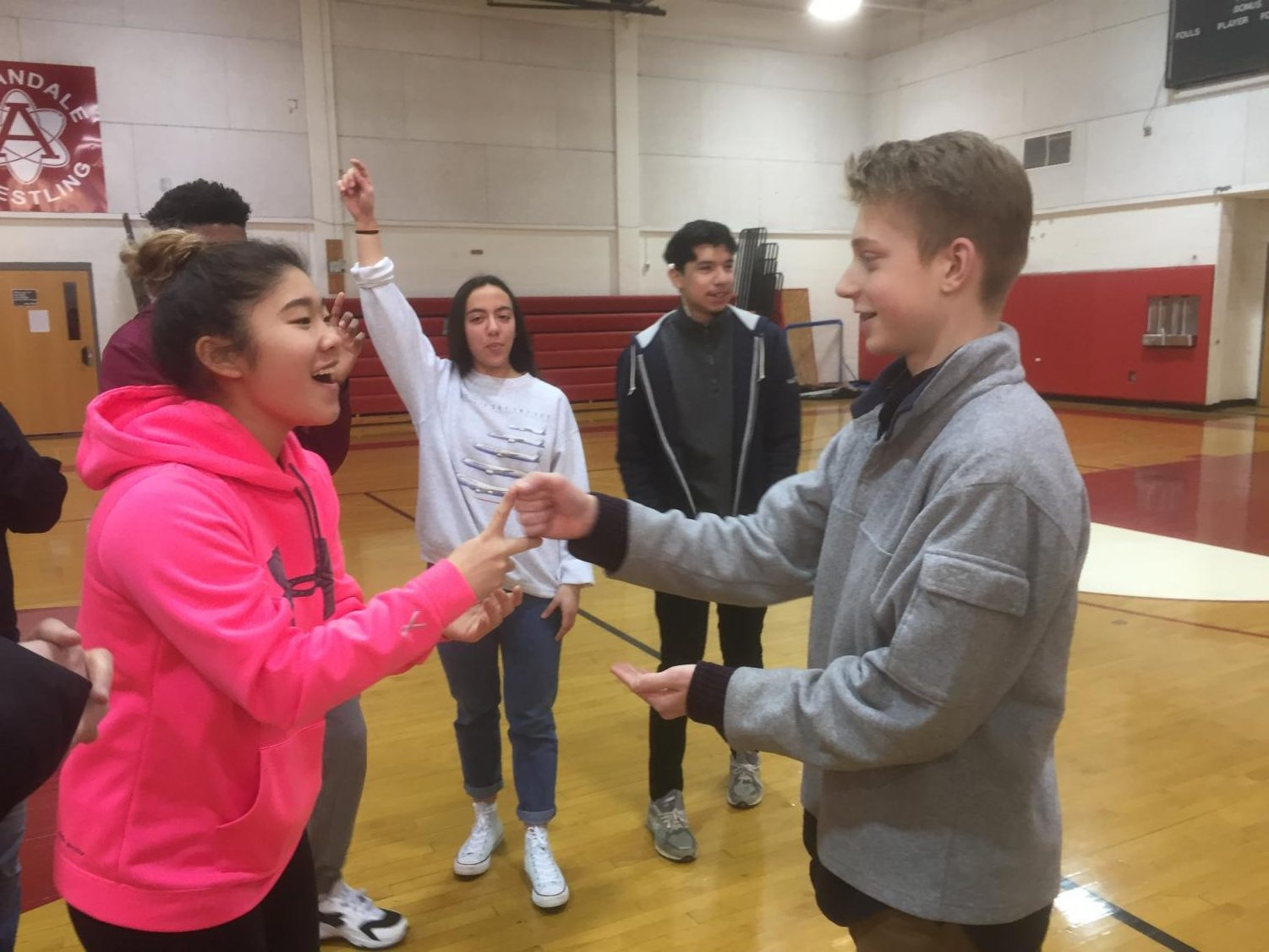 Fellowship of Christian Athletes members McKenzie Yi (Left) and Nate Peters (Right) play in a game of rock, paper, scissors during a meeting on Jan. 19.
