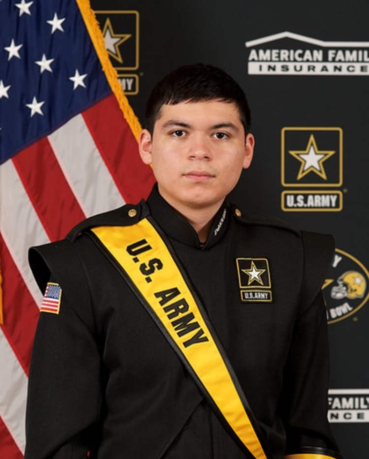 Angel Estrada is posing in his official US Army Marching Band uniform.