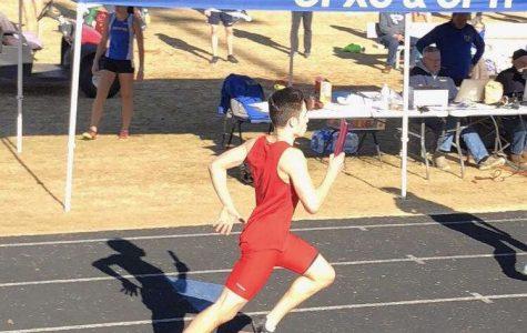 Junior  Gabe Milian runs at districts at Episcopal High School in Alexandria on Feb. 1.