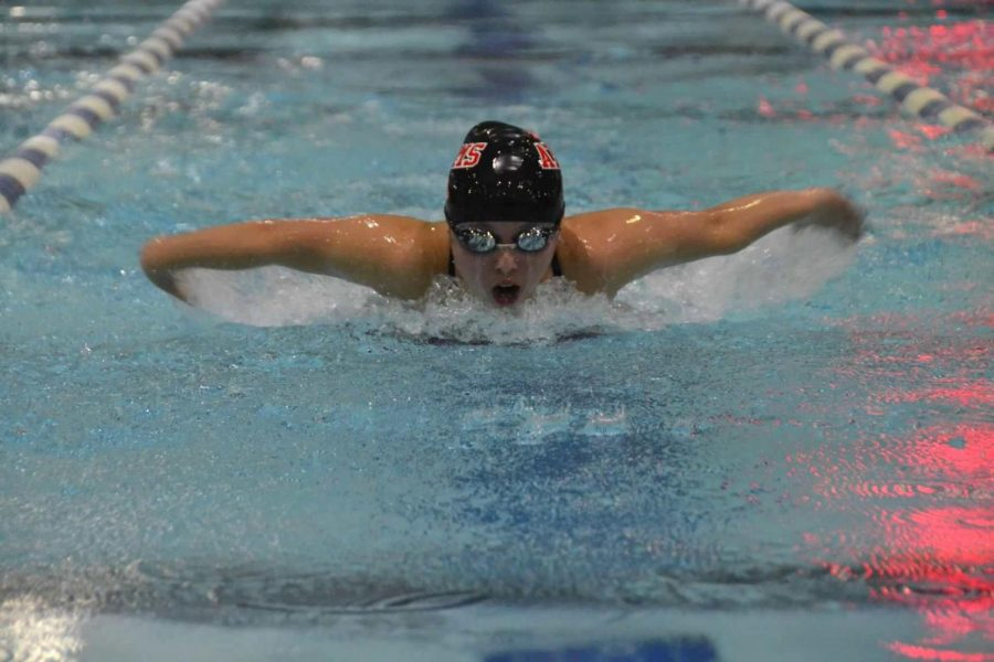 Sophomore Kia Morawetz swims the 100 yard butterfly at Lee District Rec Center in a tri-meet against Chantilly High School and Edison High School on Nov. 17.