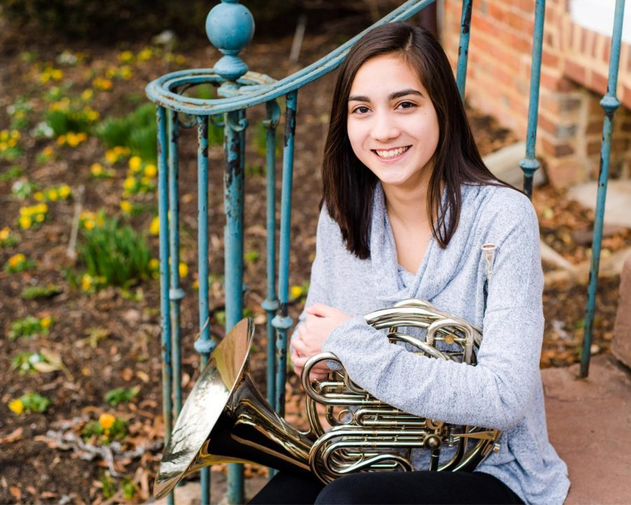 Junior Gaby Pho holds the instrument that got her a full ride to Julliard.