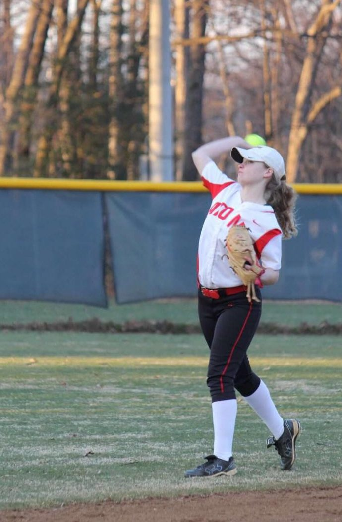 Senior shortstop Elizabeth Corcoran throws the ball during practice.