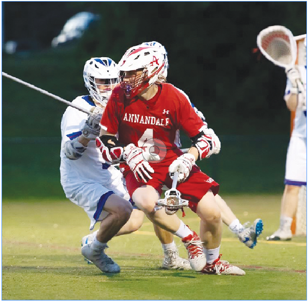 Junior Alex Bellem makes a move around a T.C. Williams player to take a shot on goal on May 9.