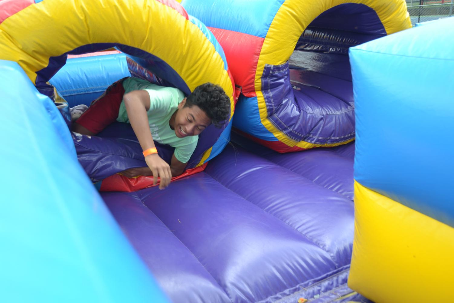Junior Alessio Humerez attended the first AHS Summer Fest last school year. One of the many attractions of the festival are inflatable slides.