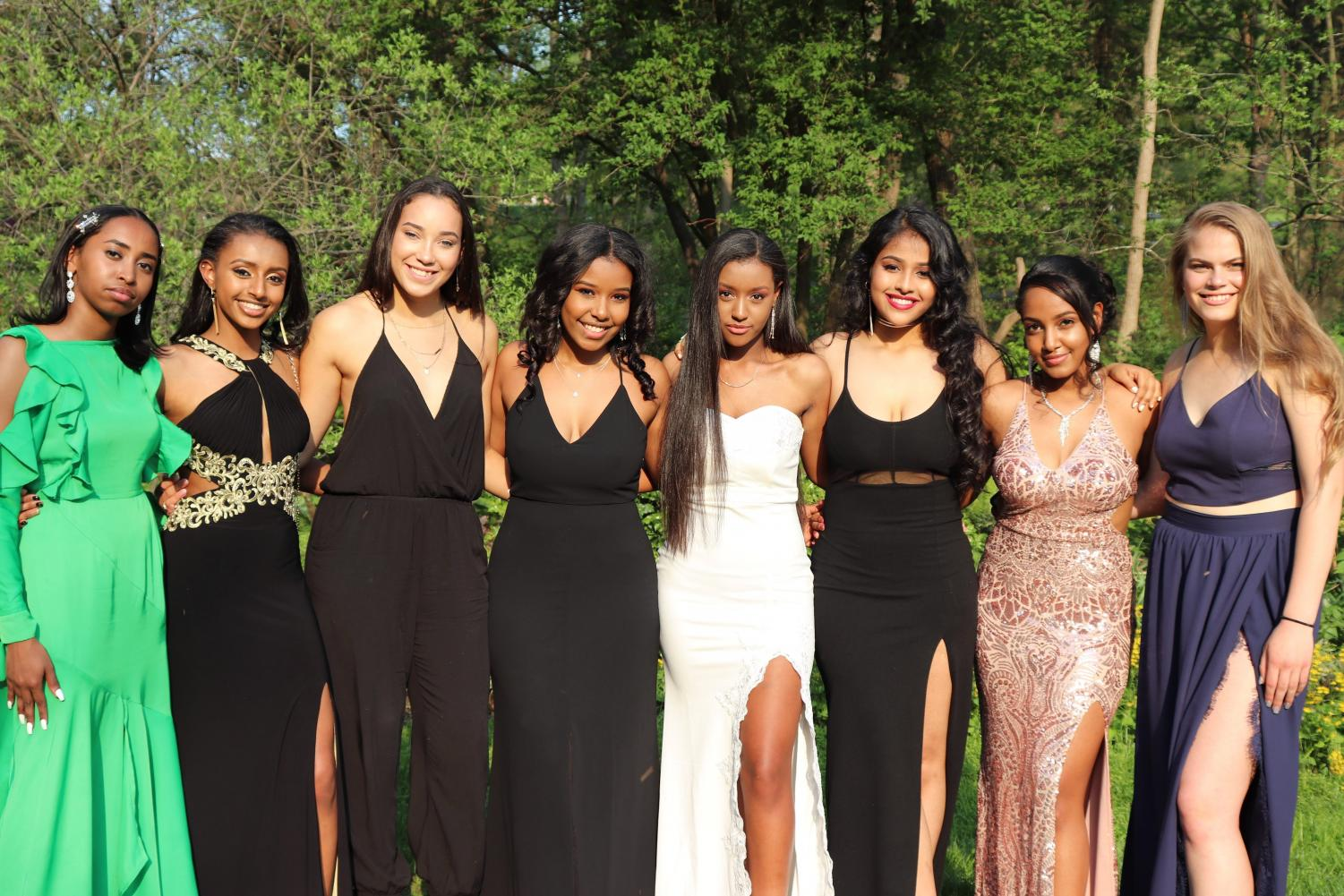 A group of prom attendees pose for a picture prior to the dance.