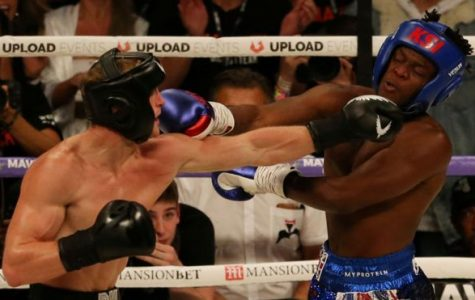 Logan Paul (left) and KSI (right) exchange blows during the third round of their fight on August 25. The fight consisted of six, three minute rounds.