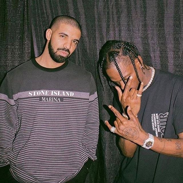 Drake (left) and Travis Scott (right) are the two artists who released the most popular albums this summer. The two pose for a photo together at Drake's album release party in late June.