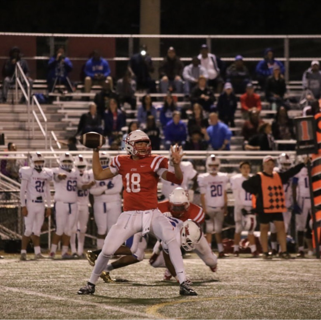 Senior starting quarterback Devin Gill drops back for a pass during a game.