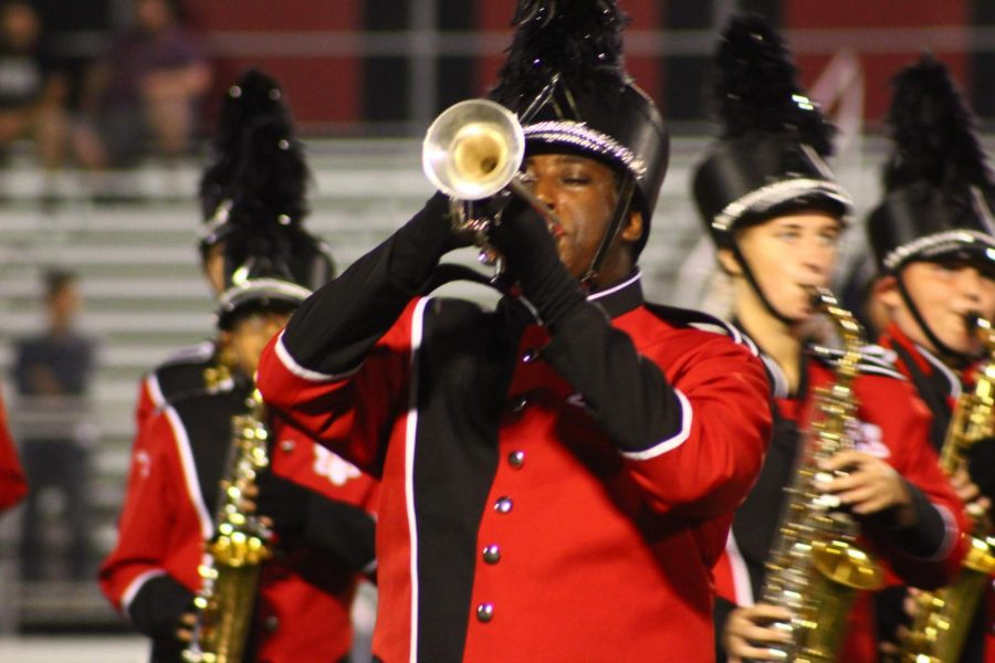 Senior%2C+Brass+Captain+and+Trumpet+Section+Leader+Sam+Berhe+performs+a+solo+during+the+halftime+performance.