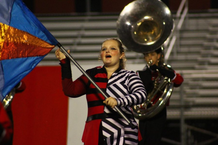 Senior and Color Guard Captain Eliza Platt performs during the Marching Band performance.