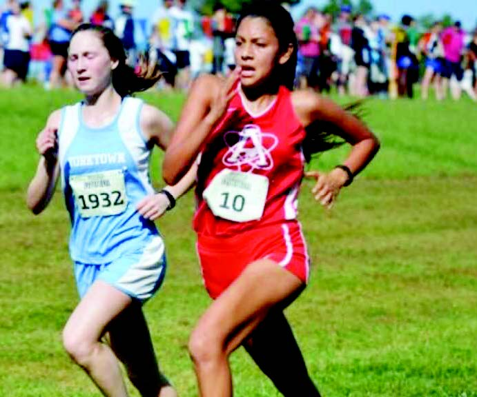Senior Vitalina Fuentes sprints toward the finish line in a fierce duel against a Yorktown runner at a past Glory Days Invitational meet.
