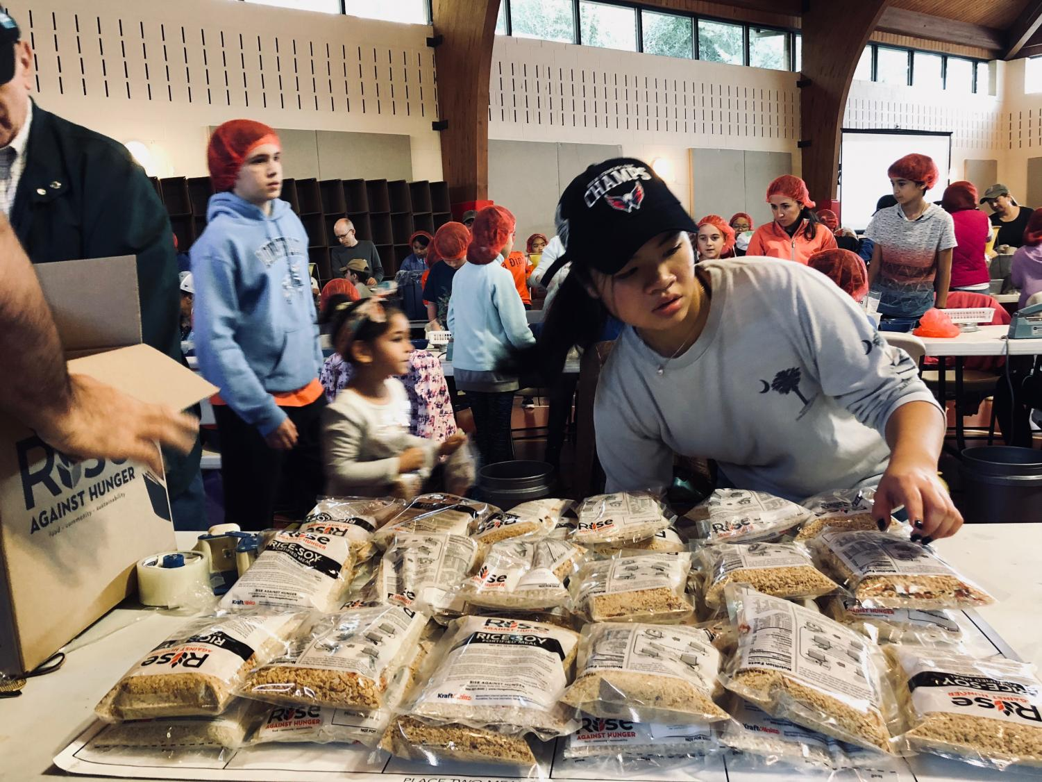 A Mission Possible member participates in the meal packaging event hosted by Rise Against Hunger on Nov. 3.