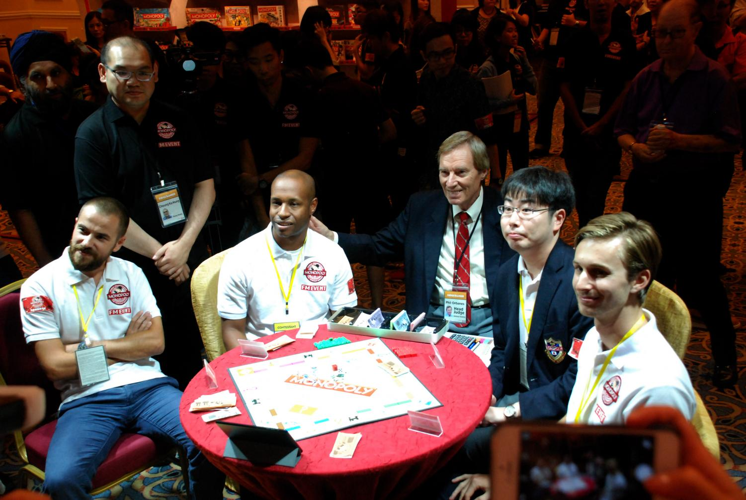 Valentine with the four world championship finalists and Monopoly judge, Phillip Orbanes in 2015.