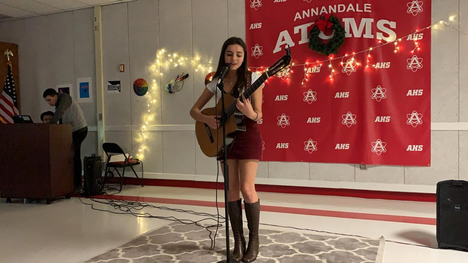 "Junior Elvera Miller performs the songs ""Untitled"" and ""Between the Bars"" at the Winter Coffee House on Dec. 12."