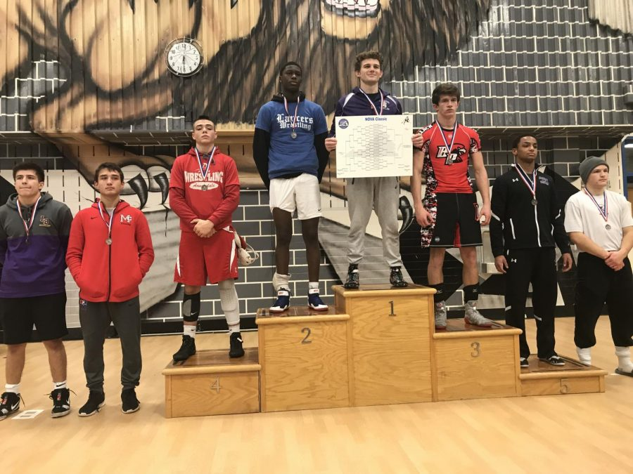 Junior Dylan Weaver steps up to the podium to celebrate his fourth place finish in his weight class bracket of 170 at the NOVA Classic tournament. His elimination in the semi-final came on Dec. 8 in a bracket featuring 32 total wrestlers.