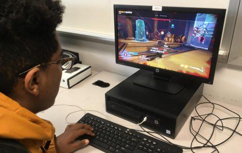 Junior Kaleab Mengistu enjoys a game of Overwatch on PC.