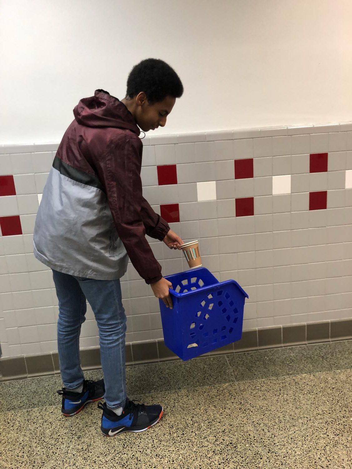 Sophomore Abdullahi Ali recycles his coffee cups.