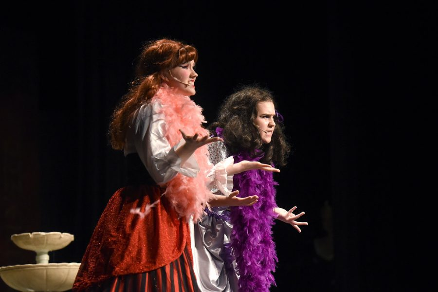 """During her sophomore year, Trachsel (left) sings and acts as one of the stepsisters, Joy, and freshman Claire Vaughn (right) as she laments about Prince Christopher and Cinderella during the song, """"The Stepsisters Lament."""""""