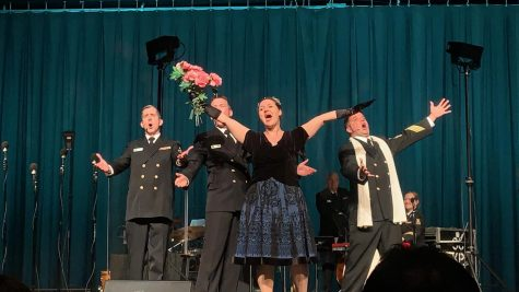 "The Navy Sea Chanters performing a theatre musical piece, ""Prima Donna,"" from Phantom of the Opera."