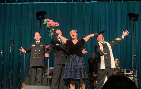 The Navy Sea Chanters performing a theatre musical piece,