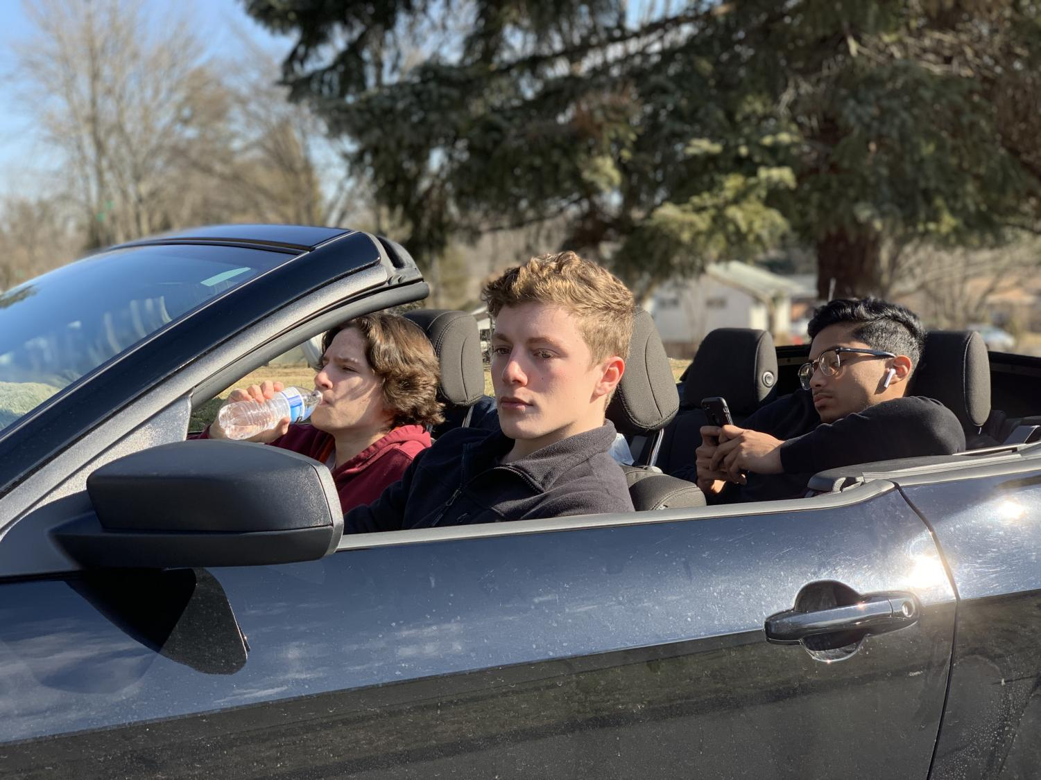 Senior James Gore commutes to school and back by driving. He is among the many teen drivers who have a school parking permit and at times, rides with friends.