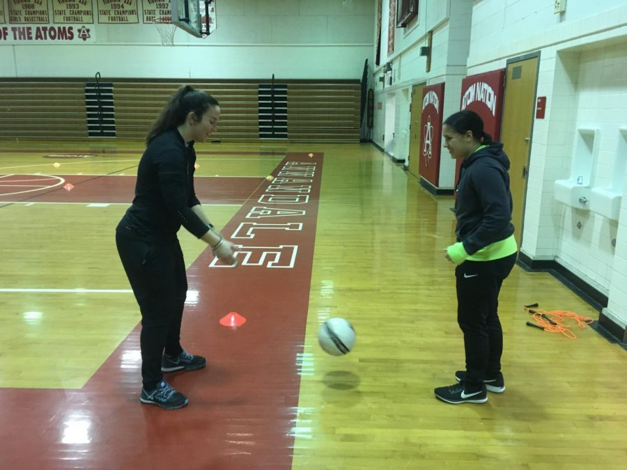 Coach+Ottavio+practices+kicking+the+ball+with+sophomore+Madison+Cruz.