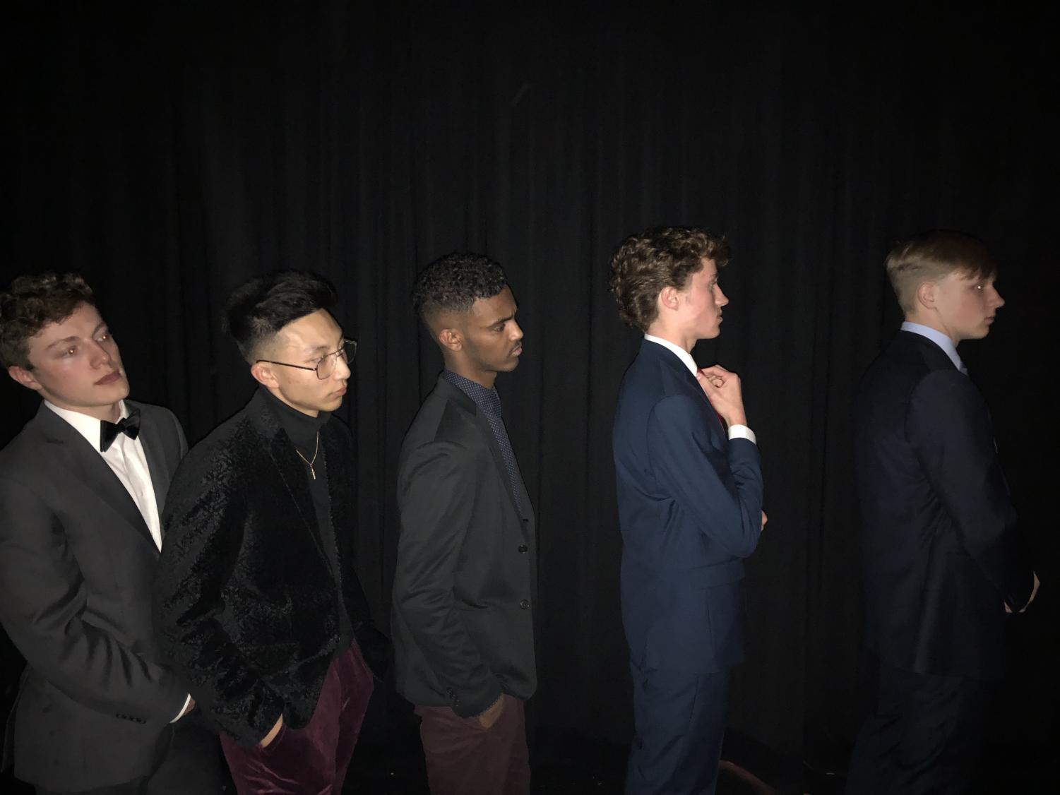 (From Left to Right) seniors James Gore, Matt DInh, Idris Dahir, Cam Foti and Alex Bellem prepare for their Mr. Elegance acts backstage.