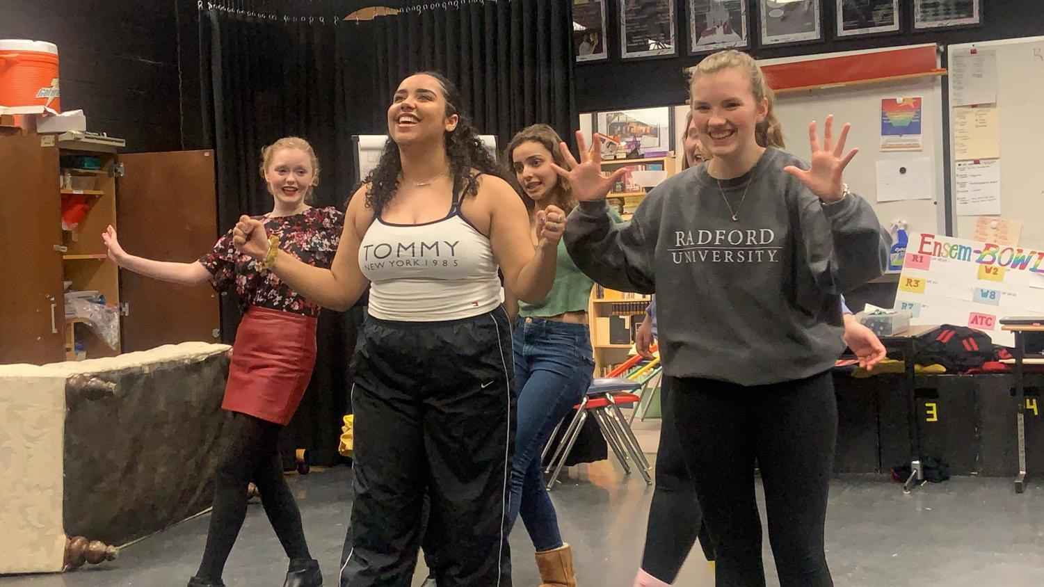 "Junior Makayla Collins (left) and senior Emily Trachsel rehearse the song, ""Amazing Mayzie,"" with the other bird girls, juniors Savannah Gravitt and Vera Miller."