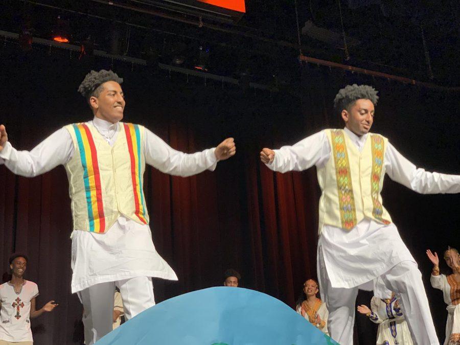 Junior Kaleab Mengistu (Left) and senior Jonathan Assefa (Right) dance on stage as part of the Habesha performance.