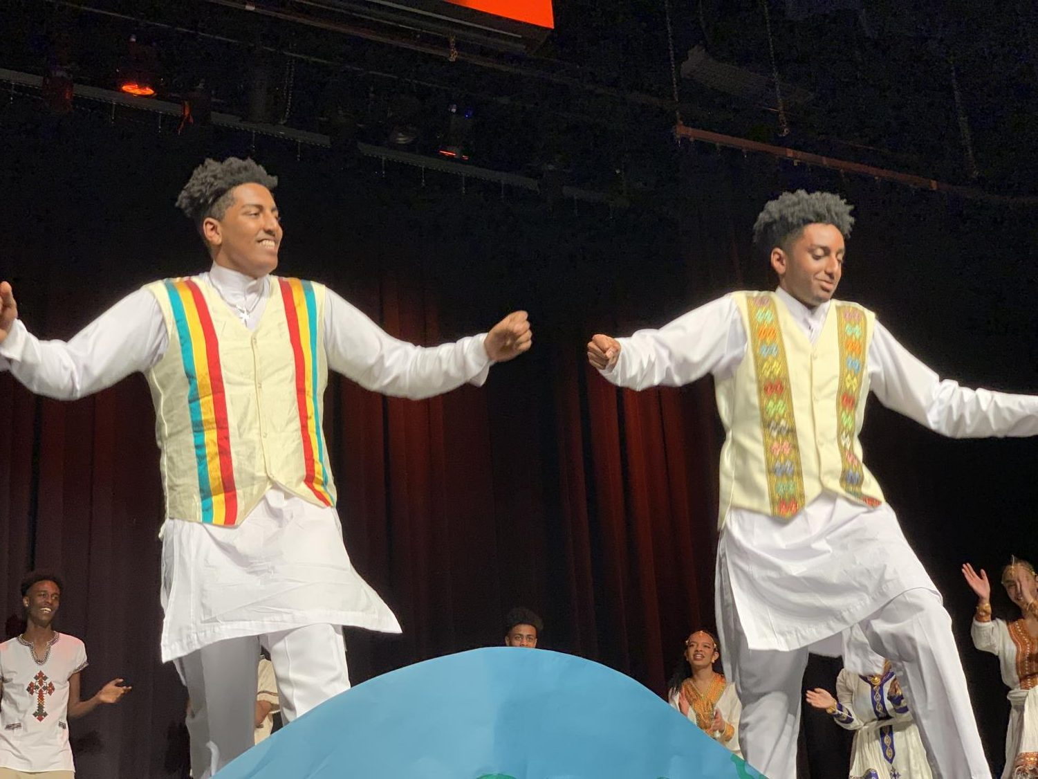 Junior Kaleab Mengistu (Left) and senior Jonathan Assefa (Right) dance on stage as part of the Habesha performance.