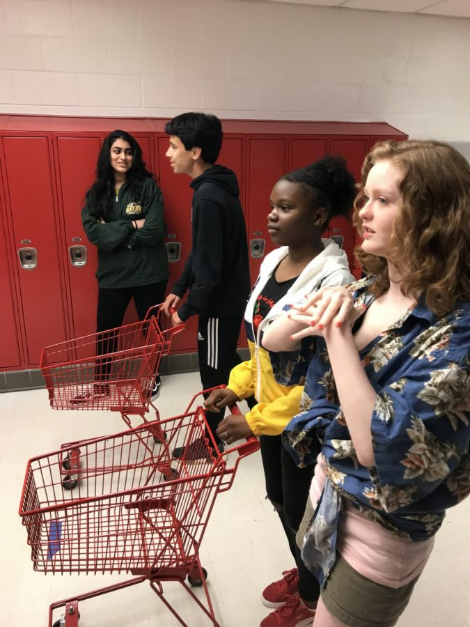 Students in English teacher Kathleen Mathis class prepare to join in their version of Guys Grocery Games last year.