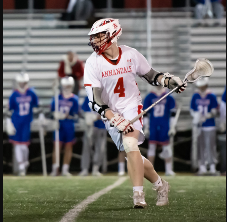 Senior Alex Bellem takes the ball up the field against TC Williams.  Bellem plans to go to Palm Beach Atlantic on a full ride scholarship to continue to play lacrosse.