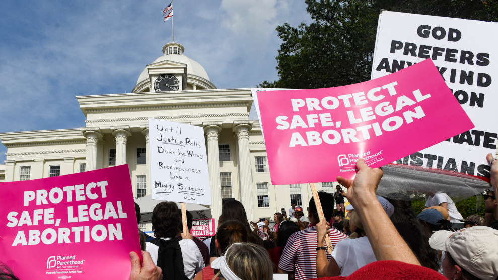 Abortion rights activists rally in front of the Supreme Court in Washington on May 21, 2019. New increasingly strict laws throughout the country have been prompting more and more protests.