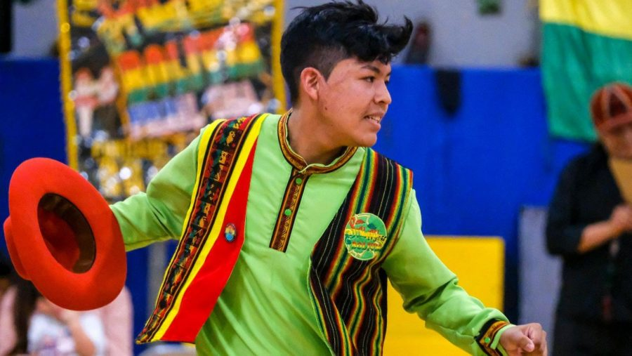 Junior Nick Belmonte dances a traditional Bolivian dance at the Salay Bolivia USA Open House earlier this year at Patrick Henry Elementary School.