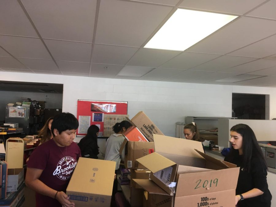 "Key Club members earn points by volunteering to unpack new English textbooks. ""It was nice to see us all working together,"" club President Megan Le said."