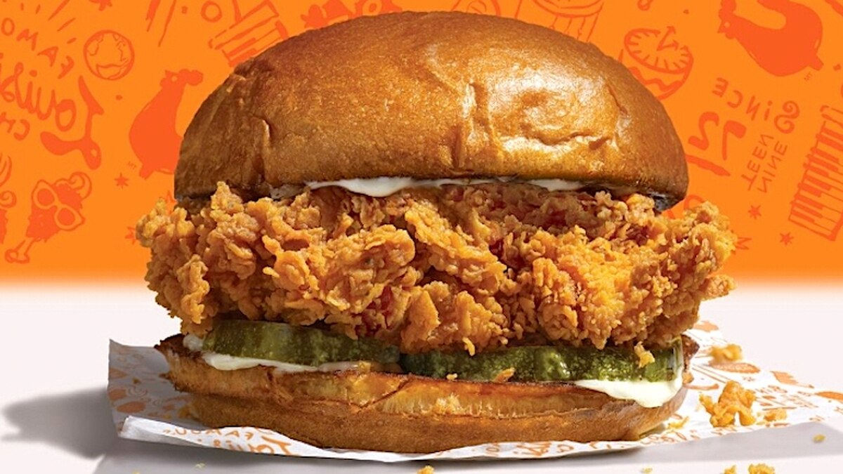 The Popeyes chicken sandwich includes a bun, mayo, pickles, and crispy chicken. A spicy version is also available.