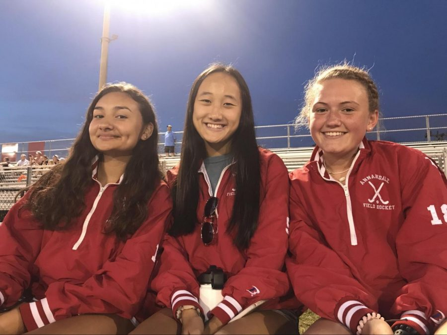 Senior Samantha Rodriguez, junior Natalie Nguyen, and sophomore Lilli Dalrymple ,watch the Atoms take on West Springfield