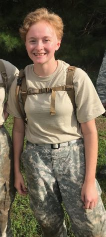 Senior Kataryna Vejcik poses in her Academy Combat Uniform at a JROTC retreat.