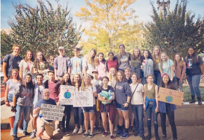 School Board member Ryan McElveen with FCPS students at the climate change protest in Washington, D.C. last month.