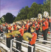 Marching Band students, who would be eligible for this grant, perform at a football game.