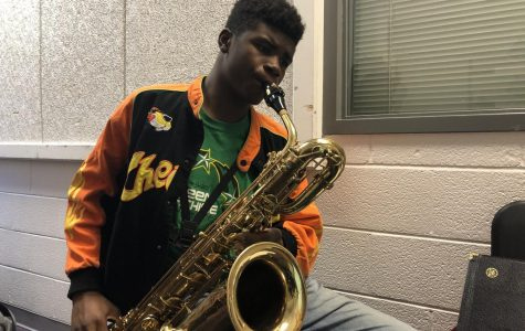 """D'yontae Jackson, 10 Bari Saxophone: """"I am auditioning to become a better player. I want to get better at my instrument because after high school, I plan on becoming a professional saxophonist. I've never done the pit before, but I've heard from others that it is a good way to improve."""""""